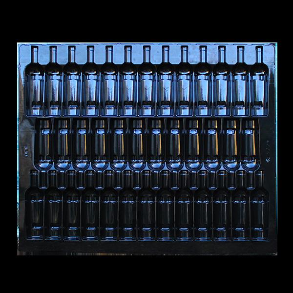 L'intercalaire thermoformée Filbox sert d'accessoire pour les bouteilles bordelaises coniques.